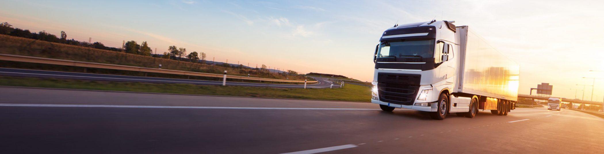 Loaded,European,Truck,On,Motorway,In,Beautiful,Sunset,Light.,On